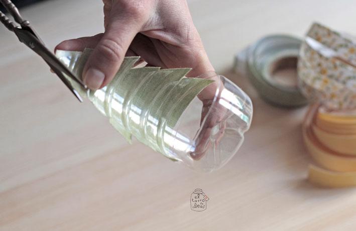Portavelas con botellas